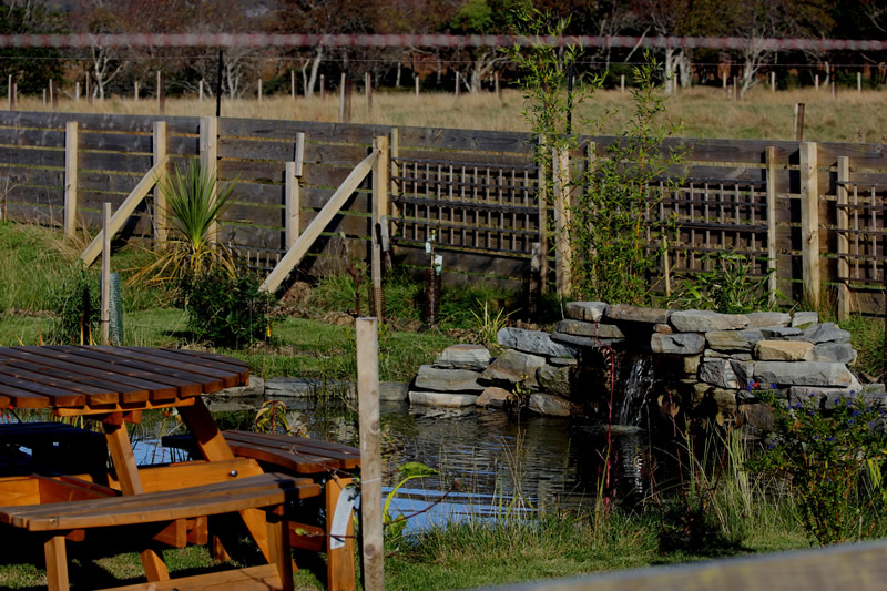 Pond and seating area at Macneils Croft Self catering house on shore of Arivegaig Bay, Ardnamurchan Scotland