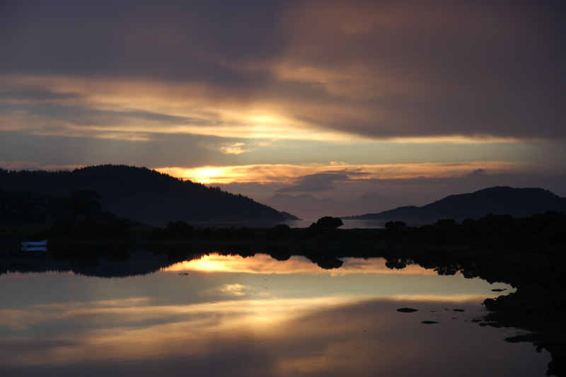 Sunset by Macneils Croft Self catering house on shore of Arivegaig Bay, Ardnamurchan Scotland